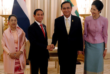 Myanmar's president Win Myint and Thailand's Prime Minister Prayut Chan-o-cha shake hand in the Government House at Bangkok