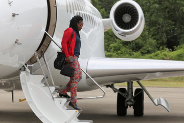 French President's press and communication advisor Sibeth Ndiaye disembarks the presidential jet after landing at French Air Force base 721 Rochefort in Saint-Agnant