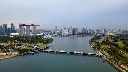 Aluminium Prints Los Angeles Aerial drone view of Singapore Marina Barrage with ships waiting out to sea