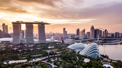 Photo sur Toile Singapoure Aerial drone view of Singapore city skyline at sunset