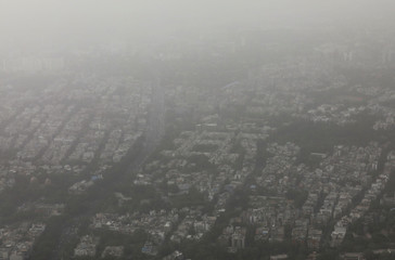 Buildings are seen blanketed by haze and dust in New Delhi