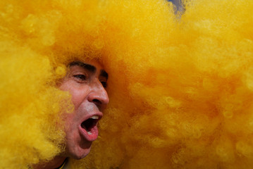 A soccer fan cheers during a gathering on the eve of the 2018 FIFA World Cup outside Luzhniki Stadium in Moscow