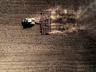tractor plowing field, top view