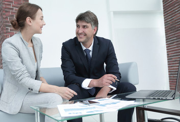 Business partners analyze the results of joint work