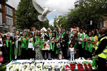 Doves are released during commemorations to mark the first anniversary of the Grenfell Tower fire, near the burn out social housing apartment block in west London