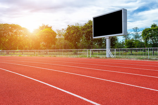 Digital blank scoreboard at football stadium with running track in sport stadium in outdoor ,Advertising Billboard LED, Empty black screen digital.