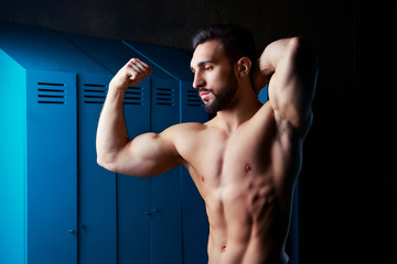 handsome muscular athletic man in the locker room