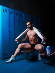 handsome muscular athletic man with a towel
