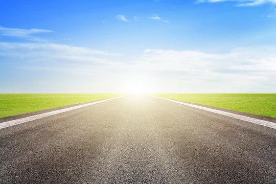 Asphalt road and blue sky background