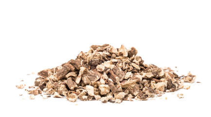 Organic dried dandelion root pile isolated on white background