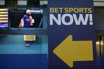 A sign is seen at Monmouth Park Sports Book by William Hill ahead of the opening of the first day of legal betting on sports in Oceanport New Jersey