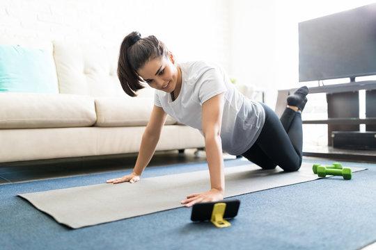 Woman exercising watching online videos