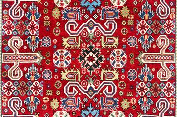 Oriental vintage handmade woolen carpet background