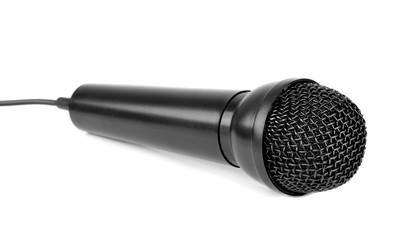 A close up of a black microphone lying on a white background