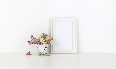 Vertical wooden frame mockup with flowers on white background