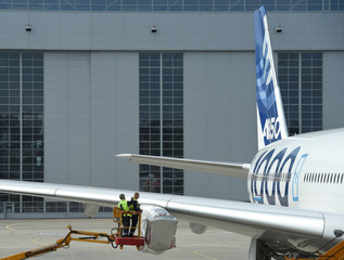 Employees of Airbus inspect an A350 plane without engines at the Airbus plant in Hamburg