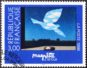 Famous painting by Magritte on french postage stamp