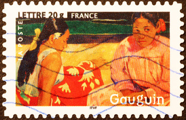 Painting of two women by Gauguin on postage stamp