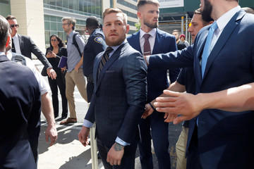 MMA fighter Conor McGregor leaves Brooklyn Supreme Court after facing a hearing on assault charges in Brooklyn