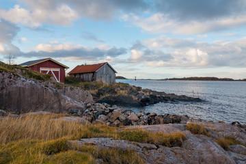 Tuinposter Scandinavië Norwegian red houses in fishing village, Norway