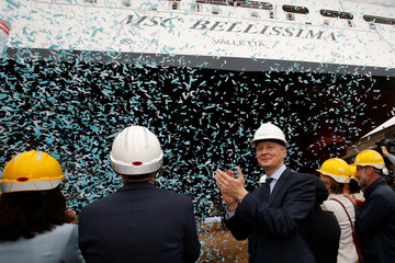 French Finance Minister Bruno Le Maire applauds during the float out ceremony of the MSC Bellissima cruise ship at the STX shipyard site in Saint-Nazaire