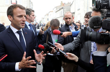 French President Emmanuel Macron speaks to the media after visiting Pierre Loti's house in Rochefort