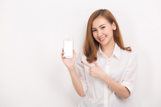 Young beautiful woman holding blank screen smart phone on white background