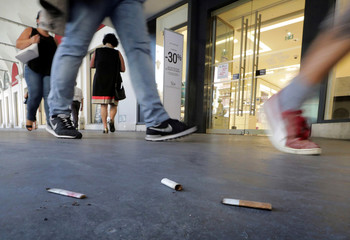 Cigarette butts litter the pavement in Nice