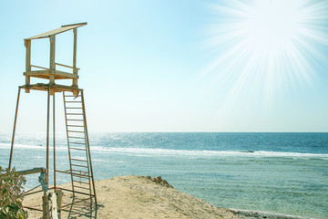 Beautiful tall watch tower on the seashore nature background