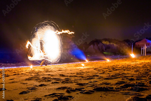 Holiday Lights In Abstract Slow Shutter >> Fire Show On The Beach Holiday Travelers Slow Shutter Speed Night
