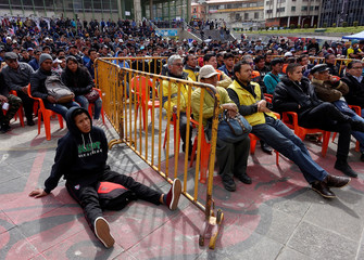 People attend a TV transmission of the opening ceremony of the World Cup in La Paz