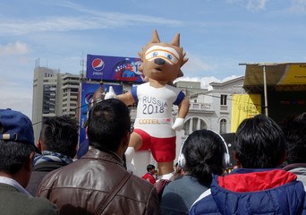 A figure of the World Cup mascot Zabivaka is seen during a TV transmission of the opening ceremony of the World Cup in La Paz