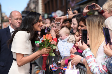 Meghan, the Duchess of Sussex, greets people during a visit to Chester