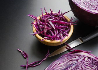 chopped red cabbage with knife