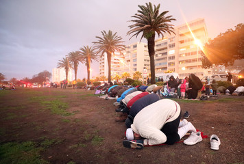 Muslims pray as they gather for the sighting of the moon in Cape Town