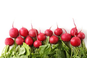 Red radishes on white background