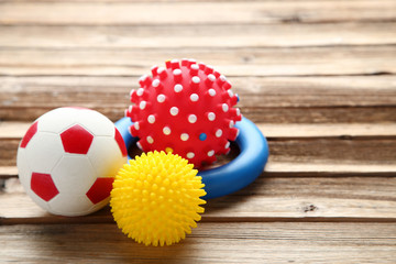 Pet toys on brown wooden table