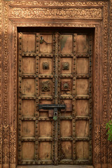 vintage carved wood and brass exterior door Baja, Mexio
