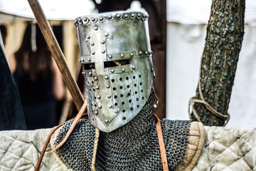 Medieval old knight helmet and chain mail for protection in battle. Very heavy headdress on stand in nature. Middle ages armor concept