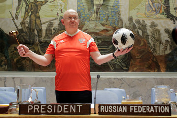 Russian U.N. Ambassador Nebenzia holds a soccer ball after members of the United Nations Security Council posed for a picture while wearing soccer jerseys to commemorate the inauguration of the Wold Cup at the United Nations headquarters in New York City