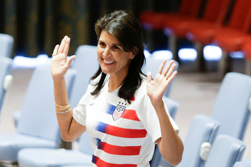 U.S. Ambassador to the U.N. Nikki Haley pose wearing soccer jerseys to commemorate the inauguration of the Wold Cup at the United Nations headquarters in New York City