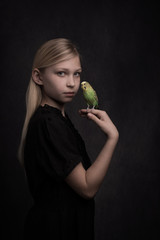 Girl with budgie