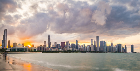 chicago,illinois,usa. 8-11-17: Chicago skyline at sunset with cloudy sky and reflection in water.