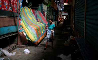 A woman walks inside of the Roberto Huembes market during National strike in Managua