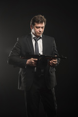 Handsome middle aged man gangster with Thompson machine gun