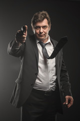 Handsome middle aged detective man with gun