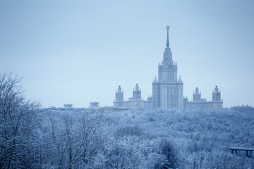 After heavy snowfall in Moscow snow-covered Lomonosov Moscow State University and park around it, aerial view