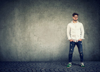 Trendy hipster man on gray background