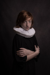 Studio portrait of boy wearing neck ruff