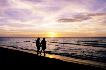 Friendship during sunset on the Cuban beach - Varadero, Cuba